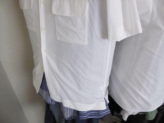 白いシャツを洋服カバーとして使っている様子